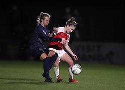 Arsenal Women's Kim Little (right) and Manchester United Women's Mollie Green (left) battle for the ball