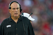 DALLAS, TX - AUGUST 30: Head Coach June Jones of the SMU Mustangs looks on against the Texas Tech Red Raiders on August 30, 2013 at Gerald J. Ford Stadium in Dallas, Texas.  (Photo by Cooper Neill/Getty Images) *** Local Caption *** June Jones