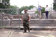 John Spain, (Left) who had six relatives fights under General Nathan Bedford Forrest,  stands by as workmen remove a pedestal, on June 2, 2021, that once held a statue of the Confederate general and early member of the Ku Klux Klan (KKK). The statue was removed after protests in December 2017. His statue stood over his grave in Health Sciences Park in Memphis, Tennessee, U.S. The remains of Forrest and his wife will be moved to Columbia, Tennessee.