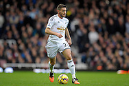 Angel Rangel of Swansea City in action. Barclays Premier league match, West Ham Utd v Swansea city at the Boleyn ground, Upton Park in London on Sunday 7th December 2014.<br /> pic by John Patrick Fletcher, Andrew Orchard sports photography.