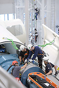 Wind Turbine Technicians working on top of a nacelle at a training facility in Orlando