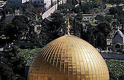 Israel, Jerusalem, Old City. The gilded Dome of the Rock Dominus Flevit church and Mount of Olives in the background