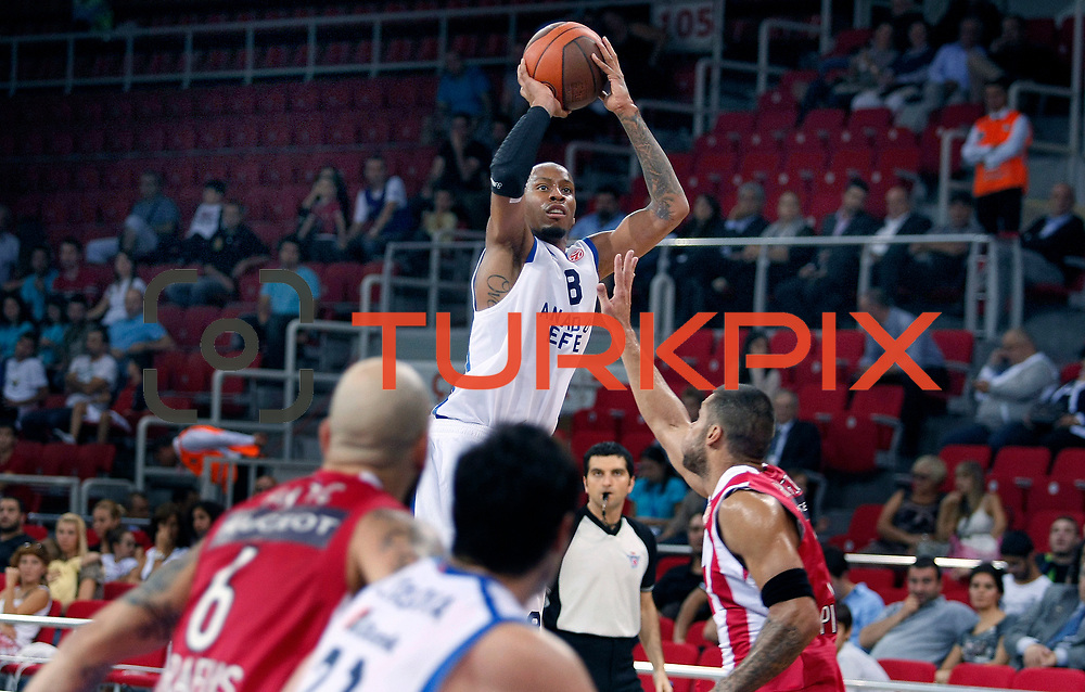 Anadolu Efes's Terence KINSEY (C) during their Two Nations Cup basketball match Anadolu Efes between Olympiacos at Abdi Ipekci Arena in Istanbul Turkey on Sunday 02 October 2011. Photo by TURKPIX