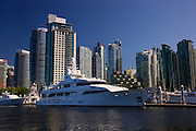 A yacht and downtown Vancouver from Coal Harbour, British Columbia, Canada.