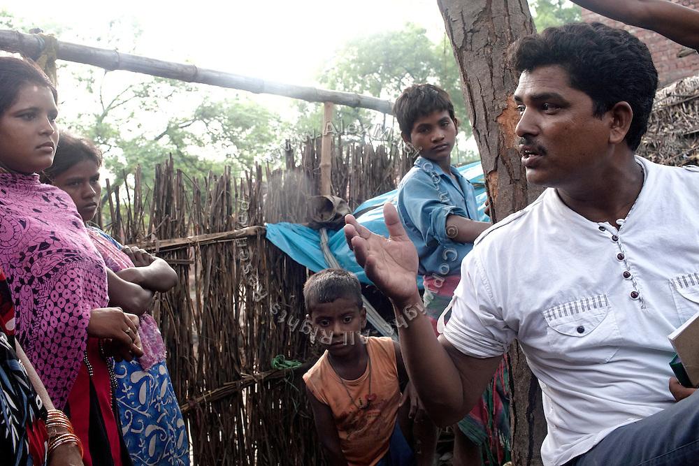 PVCHR activist Mangla Parsad, 34, is talking to villagers in Rajbhar village, around 20 kilometres from Varanasi, Uttar Pradesh, India.
