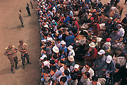 Crowd at finish line<br /> Naadam horse race<br /> Jockey's aged 4-12 years and most often girls<br /> Ulaanbaatar race track<br /> Mongolia