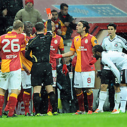 Referee's Tolga Ozkalfa show the red card to Galatasaray's Felipe Melo De Carvalho (B) during their Turkish superleague soccer derby match Galatasaray between Besiktas at the TT Arena at Seyrantepe in Istanbul Turkey on Sunday, 27 January 2013. Photo by Aykut AKICI/TURKPIX