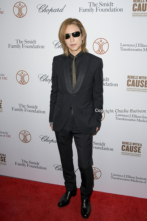 YOSHIKI HAYASHI attends the 'Rebels With A Cause'  benefitting the Lawrence J. Ellison Institute for Transformative Medicine of USC at The Water Garden in Santa Monica, California.