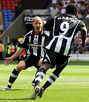 Photo: Paul Thomas. <br />Bolton Wanderers v Newcastle United. Barclays Premiership. 11/08/2007. <br /><br />Goal scorer Obafemi Martins (R) of Newcastle runs off to celebrates with Nicky Butt.