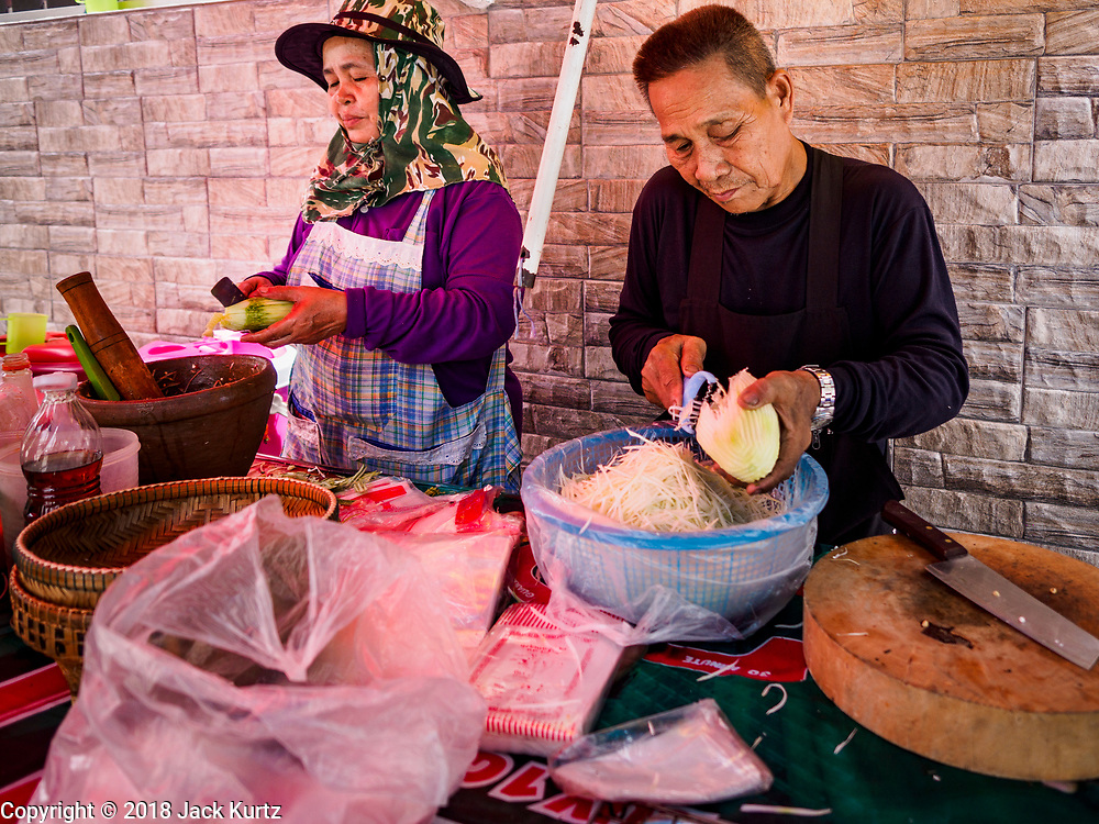 "20 SEPTEMBER 2018 - BANGKOK, THAILAND:  Making ""som tam"" (papaya salad). Street food venders of Sukhumvit Soi 16 in Bangkok.    PHOTO BY JACK KURTZ"