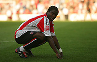 Photo: Frances Leader.<br />Brentford v Swindon Town. Coca Cola League 1.<br />15/10/2005.<br /><br />Brentford's Sam Sodje looks disapointed after the game where Brentford failed to score against Swindon despite oportunities.