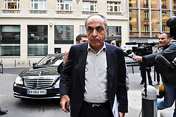 """File photo - Franco-Lebanese Ziad Takieddine, flanked by his lawyer, Ludovic Landivau (L), arrives at Paris financial crimes court on October 5, 2011, for a hearing. Takieddine, who was intermediaire sales of submarines to Pakistan and is charged for fraud and corruption in the financial aspect of """"Karachi's case"""", asked France's president Nicolas Sarkozy to remove the secrecy for national security reasons on French weapons sales contracts to Pakistan and Saudi Arabia in the 90's, he told BFM TV French TV network on September 29, 2011. Former French President Nicolas Sarkozy was in police custody on Tuesday morning March 20, 2018, an official in the country's judiciary said. He was to be questioned as part of an investigation into suspected irregularities over his election campaign financing, the same source added. The probe related to alleged Libyan funding for Sarkozy's 2007 campaign, Le Monde newspaper reported. Photo by Mousse/ABACAPRESS.COM"""