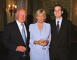 Left to right, MR & MRS PETER CADBURY and MR JAMES CADBURY, at a party in London on 5th May 1999.MRT 13