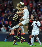 Lucy Bronze of England Women is challenged by Josephine Henning of Germany Women<br /> - Womens International Football - England vs Germany - Wembley Stadium - London, England - 23rdNovember 2014  - Picture Robin Parker/Sportimage
