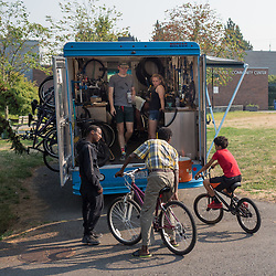 Bike Works bikemobile offers free bike repair at community centers, Seattle, Washington