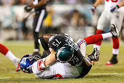 Philadelphia Eagles defensive end Vinny Curry #75 sacks New York Giants Quarterback Eli Manning #10 during the NFL game between the New York Giants and the Philadelphia Eagles at Lincoln Financial Field in Philadelphia on Sunday October 12th 2014. The Eagles won 27-0. (Brian Garfinkel/Philadelphia Eagles)