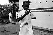 A young girl constantly counts her remaining fingers. Murraytown Amputee Camp, Freetown Sierra Leone 1999
