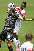 Hawke's Bay United's Gavin Hoy and Waitakere United's Shuiab Khan challenge a high ball the Handa Premiership football match, Hawke's Bay United v Waitakere United, Bluewater Stadium, Napier, Sunday, December 20, 2020. Copyright photo: Kerry Marshall / www.photosport.nz