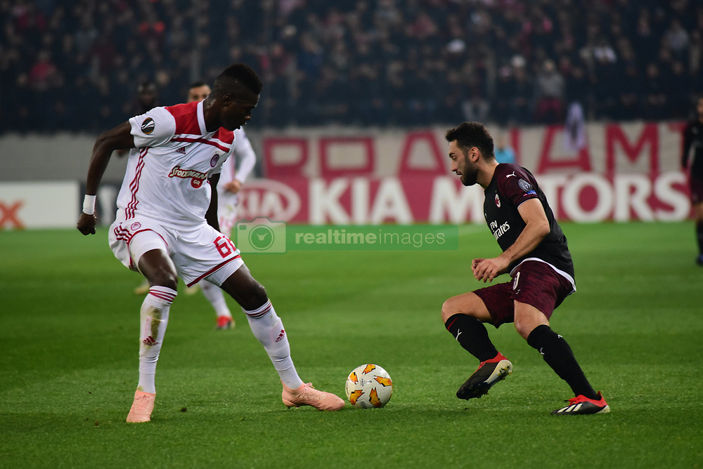 December 13, 2018 - Piraeus, Attiki, Greece - Hakan Calhanoglu (no 10) of Milan, tries to avoid Pape Abou Cisse (no 66) of Olympiacos. (Credit Image: © Dimitrios Karvountzis/Pacific Press via ZUMA Wire)