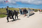 May 30, 2019, Utah Beach,  Normandy, France. Tourists stand beside a D-day monument during the 75th anniversary of D-Day and Battle of Normandy commemorations. <br /> 30 Mai 2019, Utah Beach, Normandie, France. Des touristes à coté d'un monument de débarquement pendant le 75e anniversaire des commémorations du débarquement et de la bataille de Normandie.