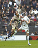 Photo: Matt Bright.<br /> Milton Keynes Dons v Stockport County. Coca Cola League 2. 27/10/2007.<br /> Danny Swailes of MK Dons &, Matty McNeil of Stockport challenge in the air