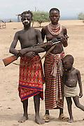 Africa, Ethiopia, Omo Valley, Daasanach tribe family Man carrying rifle