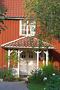 The red houses on the road in Bullerbyn Mellangården, The Middle House. The original location where Astrid Lindgren's story on Bullerbyn was filmed. In reality called Sevedstorp. Smaland region. Sweden, Europe.