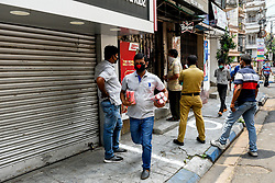 Goverment ordered to open liquor shop amidst 14 days of extended lockdown in India. Guidelines were put forth and social distancing protocols were ordered to be followed at any cost during working hour of the liquor shop in the country. Photo by Debarchan Chatterjee/ABACAPRESS.COM