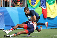 August 09, 2016; Rio de Janeiro, Brazil; USA Men's Eagles Sevens Perry Baker tackles against Franco Sabato of Argentina during the Men's Rugby Sevens Pool A match on Day 4 of the Rio 2016 Olympic Games at Deodoro Stadium. Photo credit: Abel Barrientes - KLC fotos