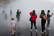 Japanese artist Fujiko Nakaya's cloud of mist, fog sculpture outside Tate Modern Switch House as part of a new live exhibition programme on March 31st 2017 in London, United Kingdom. Fujiko Nakaya is known for her immersive sculptures, made from water vapour, which are highly interactive with the art audience.