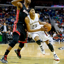 Oct 23, 2013; New Orleans, LA, USA; New Orleans Pelicans power forward Anthony Davis (23) drives past Miami Heat power forward Chris Bosh (1) during the first quarter of a preseason game at New Orleans Arena. Mandatory Credit: Derick E. Hingle-USA TODAY Sports