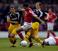 Photo: Jed Wee.<br />Nottingham Forest v Weymouth. The FA Cup.<br />05/11/2005.<br />Forest's Jack Lester (C) is tackled by Weymouth's Sean Wilkinson.