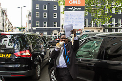 "Mayfair, London, May 24th 2016. Drivers from minicab operator Addison Lee bring traffic to a standstill in Berkely Square, outside of the offices of owner Carlyle Group, in protest against new ""unfair"" pay rates as the company battles to compete with cut-price Uber, with some drivers claiming they are earning as little as £4.99 per hour. PICTURED: Minicabs sound their horns outside Landsdowne House, where Carlyle Group is headquartered"