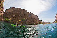 A group of paddlers explore The Black Canyon, Nevada.