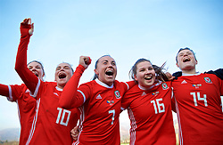 ZENICA, BOSNIA AND HERZEGOVINA - Tuesday, November 28, 2017: Wales players celebrate the 1-0 victory over Bosnia and Herzegovina during the FIFA Women's World Cup 2019 Qualifying Round Group 1 match between Bosnia and Herzegovina and Wales at the FF BH Football Training Centre. Jessica Fishlock, Natasha Harding, Alice Griffiths, Hayley Ladd. (Pic by David Rawcliffe/Propaganda)