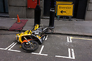 While parked in a designated space, a motorbike has been blown over in high winds in a central London side street.