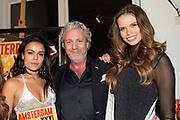 Launch van de nieuwe AmsterdamXXXL 5 in Momo, Amsterdam.<br /> <br /> Op de foto:  mark teurlings geeft het eeerste exemplaar aan Farrieda Smit en Nicky Opheij