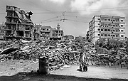 Two small children amongst the rubble. Palestinian Refugee Camps of Sabra and Shatila, Beirut, Lebanon 1998.