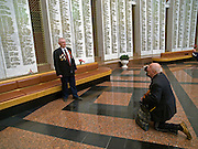 Der 85 jährige ukrainische 2. Weltkriegs Veteran Ivan Dmitrievich Dunayev (rechts) fotografiert seinen Freund in der Ruhmeshalle im Museum des Großen Vaterländischen Krieges in Moskau auf der Suche nach den Namen Ihrer im 2. Weltkrieg gefallenen Kameraden. Dunayev erreichte Berlin kurz vor der deutschen Kapitulation am 2. Mai 1945. Die beiden Veteranen sind zur Siegesparade (9.Mai 2008) nach Moskau angereist.<br /> <br /> The 85 years old Ukrainian WW II veteran Ivan Dmitrievich Dunayev (rechts) photographing his friend infront of names of their comrades fallen during the second World War at the pantheon in the Museum of the Great Patriotic War in Moscow. Dunayev arrived at the 2nd of May 1945 to Berlin - a few days before Germany surrendered. Both WW II veterans travelled for the Victory Parade (09.05.2008) to Moscow.