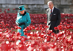 File photo dated 16/10/14 of Queen Elizabeth II and the Duke of Edinburgh visiting the Tower of London's Blood Swept Lands and Seas of Red installation. The Duke of Edinburgh has died, Buckingham Palace has announced. Issue date: Friday April 9, 2020.. See PA story DEATH Philip. Photo credit should read: Chris Jackson/PA Wire