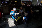 UNITED KINGDOM, London: 27 May 2018 A cosplay fan eats his lunch in a ray of sunlight at the MCM London Comic Con earlier today. The three day comic convention, which is held at London's ExCeL, was visited by thousands of avid cosplay fans and enthusiasts. Rick Findler / Story Picture Agency