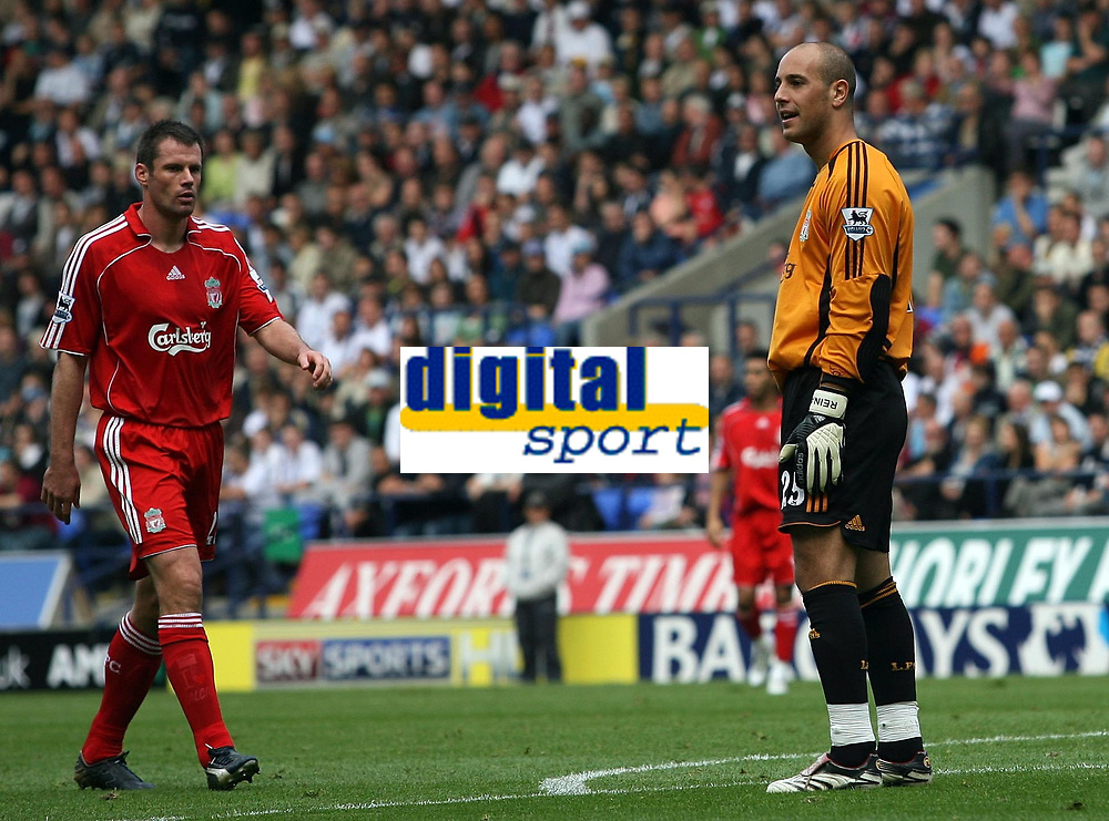 """Photo: Paul Thomas.<br /> Bolton Wanderers v Liverpool. The Barclays Premiership. 30/09/2006.<br /> <br /> Jose Reina of Liverpool (R) can't believe he gave away a penalty for """"handling"""" out side the box."""