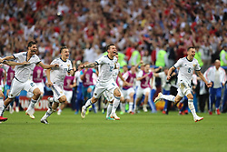 Russia's (left-right) Aleksandr Yerokhin, Roman Zobnin, Fyodor Smolov and Denis Cheryshev celebrate defeating Spain 3-4 on penalties