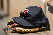 The glove, hat, and sunglasses of Joe Mauer #7 of the Minnesota Twins sit on the dugout steps during a game against the Seattle Mariners on June 2, 2013 at Target Field in Minneapolis, Minnesota.  The Twins defeated the Mariners 10 to 0.  Photo: Ben Krause