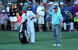 Charley Hoffman takes a drop after hitting into the water on the 16th hole during the third round of the Masters Tournament at Augusta National Golf Club in Augusta, Ga., on Saturday, April 8, 2017. (Photo by Curtis Compton/Atlanta Journal-Constitution/TNS) *** Please Use Credit from Credit Field ***