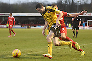 Jamie Murphy takes the ball past Ryan Dickson into the penalty area during the Sky Bet League 1 match between Crawley Town and Sheffield Utd at Broadfield Stadium, Crawley, England on 28 February 2015. Photo by David Charbit.