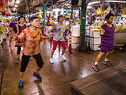 25 AUGUST 2016 - BANGKOK, THAILAND:  An aerobics class in Pak Khlong Talat, better known as the Bangkok Flower Market. Public exercise classes are common throughout Thailand and a component of the country's public health program. Most of the participants in the exercise class in the Bangkok flower market are older adults, although the class is open to everyone.      PHOTO BY JACK KURTZ