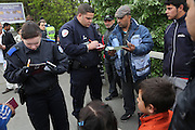 French police control the papers of Romanian Roma Gypsy families and their children, who might recieve a few nights temporary accomodation, after their squatter camp home was destroyed this morning. Seine St Denis, Paris suburbs<br /><br />Roma Gypsies in Paris: Romanian Roma living in difficulty who have come to France looking for a better live, find themselves in a similiar predicament, facing racism from the general populus and systematic controls and evictions from their makeshift squatter camps in the suburbs and temporary places of abode inside Paris. Some recycle metal or suft through the rubbish bins looking for items to sell. Others beg or play music looking for handouts from passers by. Paris and Banlieu, Ile de France, France April 2014