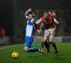 Bristol Rovers' Chris Beardsley falls under a challenge from Morecambe's Tony Diagne - Photo mandatory by-line: Dougie Allward/JMP - Tel: Mobile: 07966 386802 14/12/2013 - SPORT - Football - Morecombe - Globe Arena - Morecombe v Bristol Rovers - Sky Bet League Two
