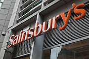 The Sainsbury's sign, outside their Sainsbury's Supermarkets branch support office on Fetter Lane, London.